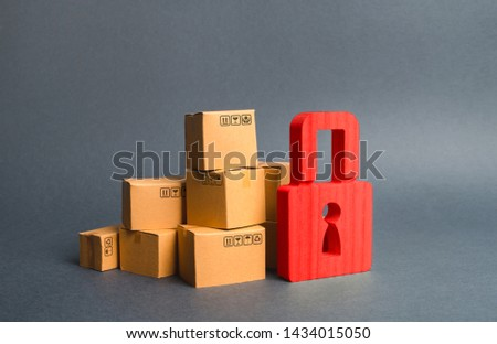 A stack of cardboard boxes and a red padlock. concept of insurance purchases. Consumer rights Protection. cargo arrest customs clearance. ban on the import. Providing warranty on purchased products. #1434015050