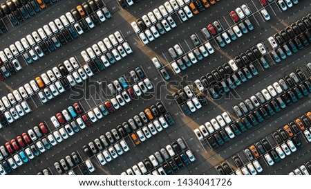 Aerial view of the parked new cars at the automotive plant Royalty-Free Stock Photo #1434041726