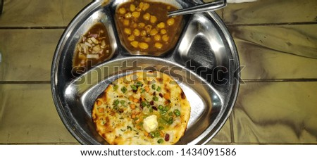 Spicy chick peas curry or Chola Masala or Chana Masala or Chole Kulche with flour chapati & Butter. A popular dish in most of the people in North of India. Amritsari kulcha with chola. #1434091586