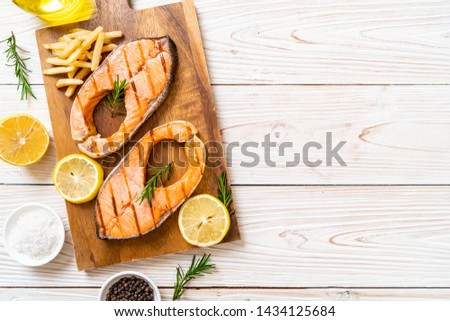 grilled salmon steak fillet with lemon #1434125684
