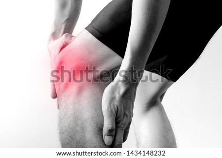 Black and white picture .Knee pain .man stand hand caught at the knee.  health concepts