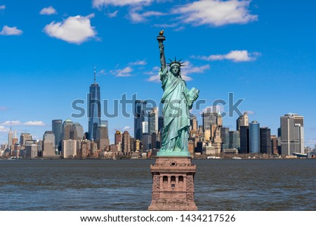 The Statue of Liberty over the Scene of New york cityscape river side which location is lower manhattan,Architecture and building with tourist concept #1434217526