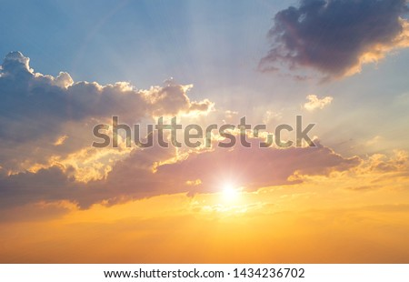 Twilight sky background. Colorful Sunset sky and cloud.vivid sky in twilight time background.Fiery orange sunset sky. Beautiful