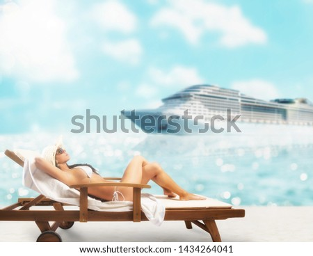 Beautiful girl sitting on a deck chair at the beach at sunset with cruiseship on background