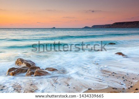 Sunset on the beach at at Sennen Cove on the Penwith Coast of Cornwall England UK Europe