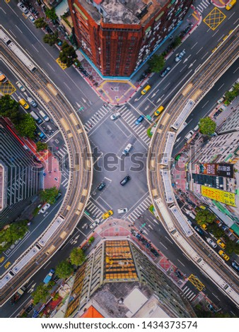 Taipei, Taiwan - 06/26/2019 : Aerial view of cars and trains with intersection or junction with traffic, Taipei Downtown, Taiwan. Financial district and business area. Smart urban city technology. #1434373574