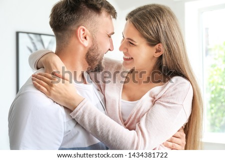 Portrait of happy young couple at home #1434381722