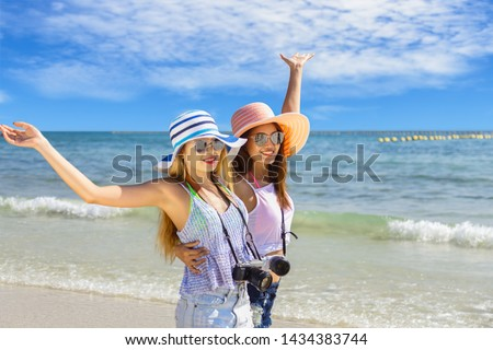 Couple girl running on the beach relaxing summer vacation.Young fashion woman relax on the beach. Happy island lifestyle.crystal. Vacation at Paradise. Ocean beach relax. Royalty-Free Stock Photo #1434383744