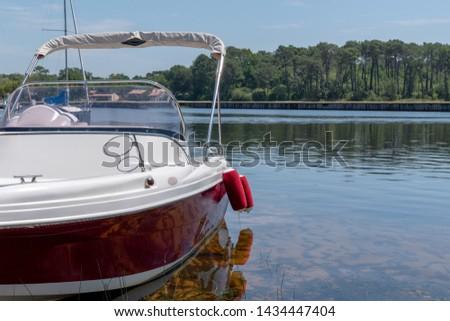 modern new boat moored in lake in Lacanau France #1434447404