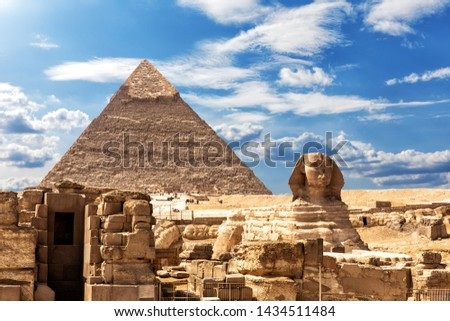 The Sphinx, the Temple and the Pyramid of Chephren under the clouds in Giza #1434511484