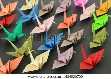 Origami cranes on black background #1434520700