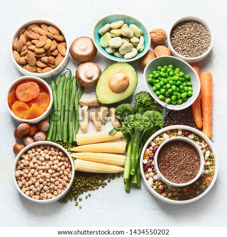 Food sources of plant based protein. Healthy diet with  legumes, dried fruit, seeds, nuts and vegetables.  Foods high in protein, antioxidants, vitamins and fiber. #1434550202