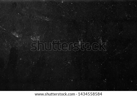 white dust and scratches on a black background. The texture of dirt on the glass. Royalty-Free Stock Photo #1434558584