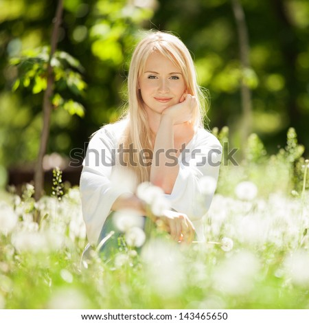 Cute woman rest in the park with dandelions #143465650