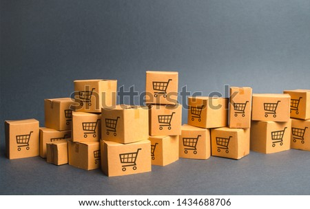Many cardboard boxeswith drawing of shopping carts. products, goods, Warehouse, stock. commerce and retail. E-commerce, sale of goods through online trading platform. Freight shipping, deliver #1434688706