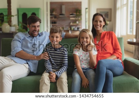 Front view of happy Caucasian family sitting together on sofa in living room art home #1434754655