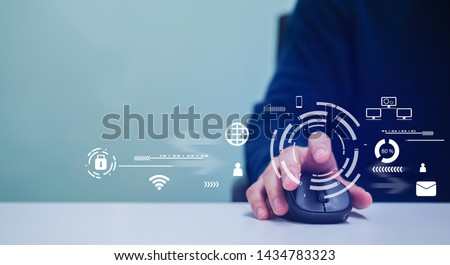 close up professional programmer man hand using mouse cursor for scrolling and working about protection of cyber security and malware attack at computer desktop in office  with technology concept Royalty-Free Stock Photo #1434783323