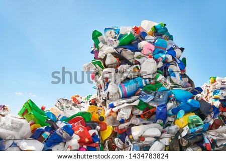 Mountains of plastic rubbish outdoors at recycling factory near the dump Royalty-Free Stock Photo #1434783824