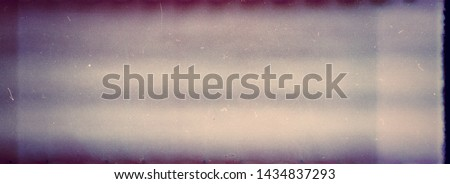 Designed film texture background with heavy grain, dust and light leak #1434837293
