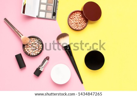 Creative Fashion background. Set of decorative cosmetics mascara powder lipstick eyeshadow blush makeup brush on colorful background top view Flat lay copy space. Beauty blogger concept. Makeup  #1434847265
