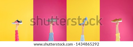 Set of women holding different stylish shoes on color background, closeup Royalty-Free Stock Photo #1434865292