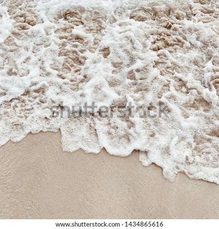 Beautiful tropical beach with white sand and sea with white frothy waves on Phuket, Thailand. Minimal composition with neutral colors. Summer and travel concept. Natural background. Royalty-Free Stock Photo #1434865616
