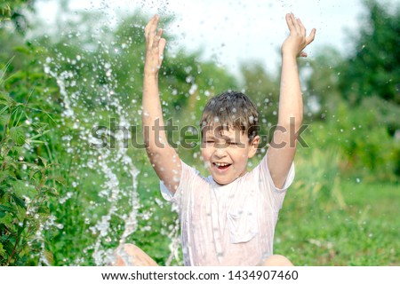 A happy happy happy boy frolicking in the basin. outdoors in summer, spraying water. #1434907460