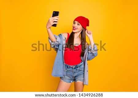 Portrait of charming lady make photos device gadget video calling travel trip isolated over yellow background #1434926288