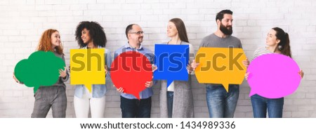 Forum. Cheerful diverse people holding empty colorful speech bubbles, copy space #1434989336