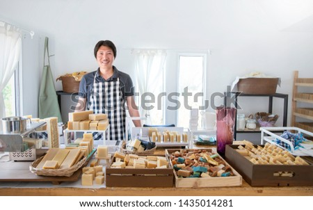 Startup successful Asia sme small business entrepreneur owner asian man standing in handmade organic oil spa soap shop. Portrait of asian man successful seller owner environment friendly concept #1435014281
