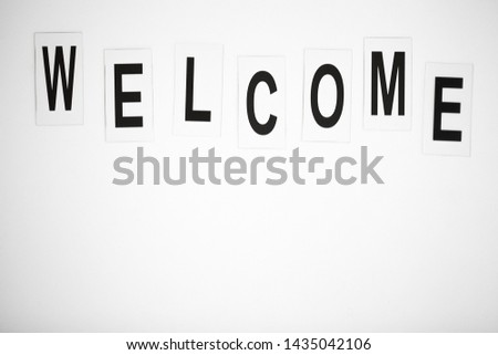 Welcome word written on white table. Copy space #1435042106