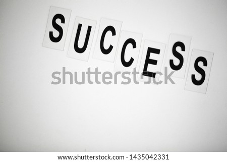 Success word written on white table. Copy space #1435042331