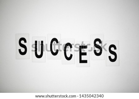 Success word written on white table. Copy space #1435042340