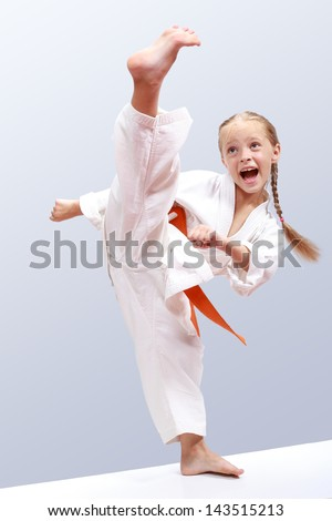 Professional karate girl Royalty-Free Stock Photo #143515213