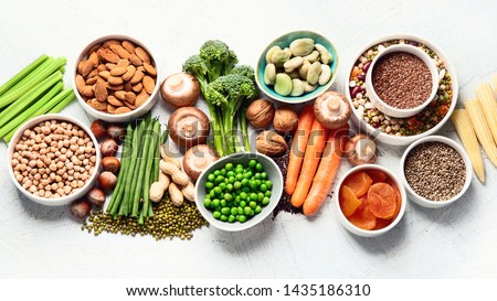 Food sources of plant based protein. Healthy diet with  legumes, dried fruit, seeds, nuts and vegetables.  Foods high in protein, antioxidants, vitamins and fiber. #1435186310