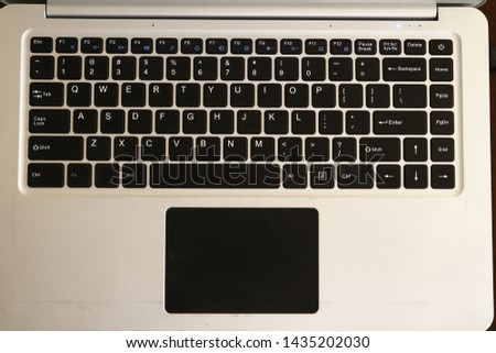 Over head or top shot photo of laptop computer keyboard #1435202030