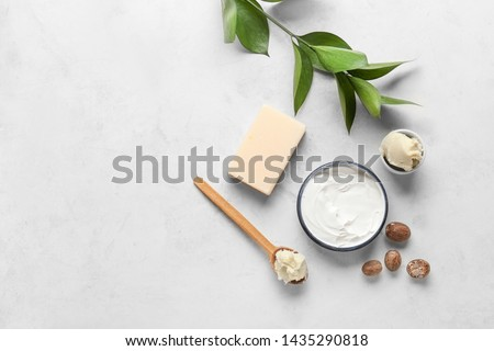 Shea butter with cream and soap on light background #1435290818