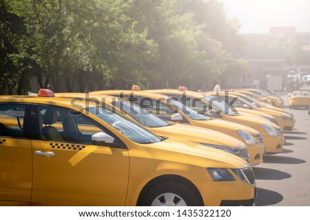 Photo of several yellow taxi on street in summer afternoon #1435322120