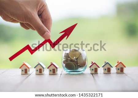 House and coins on table. Property investment and house mortgage financial concept,  #1435322171