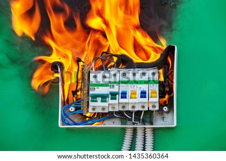 Bad electrical wiring system in electrical switchboard became the cause of fire. A faulty circuit breaker caught fire in a switchboard and caused a household electrical fire. #1435360364