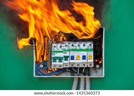 Damaged circuit breaker became the cause of electrical short circuit and caused the switchboard to ignite of fire. Bad electrical wiring systems caused fire inside electrical fuse box of home wiring. #1435360373