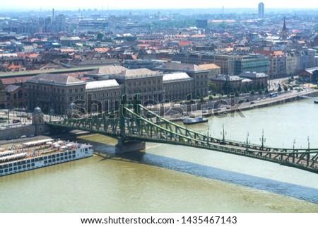 12.06.2019. Budapest, Hungary. A look the city and the Green old Bridge through the Danube River. Traffic intersection. #1435467143