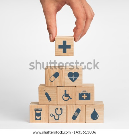 Concept of Insurance for your health, Hand hold wooden block with icon healthcare medical #1435613006