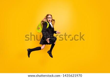 Full size photo of astonished child have bag backpack stylish trendy eyewear eyeglasses skirt scream isolated over yellow background #1435621970