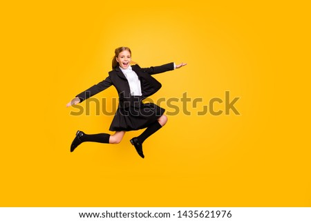 Full body photo of charming stylish trendy kid raise arms hands scream shout laughing isolated over yellow background #1435621976