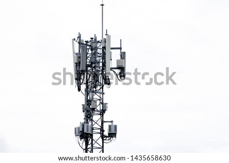 Telecommunication tower of 4G and 5G cellular. Base Station or Base Transceiver Station. Wireless Communication Antenna Transmitter. Telecommunication tower with antennas isolated on white background. #1435658630