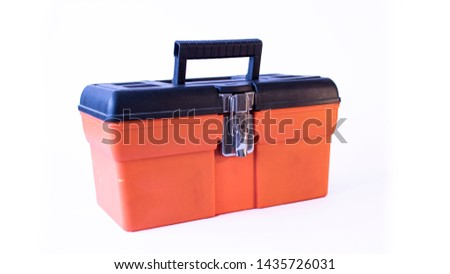 An orange tool box on an isolated white background. #1435726031