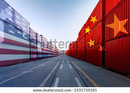 Metaphor image of United States of America and China trade war tariffs as two opposing container cargo and airplane over the port as an economic taxation dispute over import and exports concept #1435739585