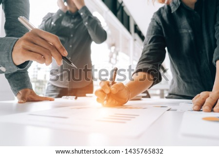 Business people analyzing investment graph meeting brainstorming and discussing plan in meeting room, investment concept #1435765832