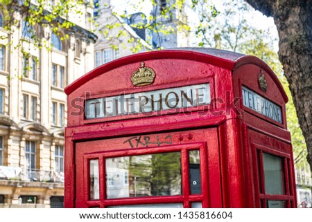Red Telephone Box in the City Center of London UK #1435816604